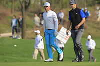 Mikko Ilonen (FIN) and Ross Fisher (ENG) walk onto the 16th green during Sunday's Final Round of the 2014 BMW Masters held at Lake Malaren, Shanghai, China. 2nd November 2014.<br /> Picture: Eoin Clarke www.golffile.ie