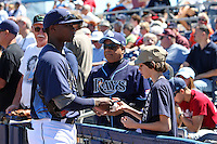 Tampa Bay Rays shortstop Tim Beckham #29 signs autographs before a spring training game against the Baltimore Orioles at the Charlotte County Sports Park on March 5, 2012 in Port Charlotte, Florida.  (Mike Janes/Four Seam Images)