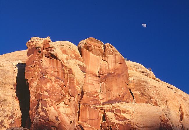 sunset on redrock cliffs and moonset, Canyonlands National Park, Ut.
