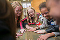 Duke sophomore Lucy Greenwald, left, plays a team-building game with Portia Bryner, 10, and Imani Khamala, 9, between science activities of FEMMES' (Females Excelling More in Math, Engineering, and Science) Capstone event. The event was a free, annual one-day outreach program introducing young women from Durham (4th through 6th grade) to math, science and engineering. <br /> The goal of FEMMES (Females Excelling More in Math, Engineering and Science) is to give girls hands-on experience in fields where women are often greatly under-represented. By using female volunteers and faculty members, we hope to demonstrate that women can and do excel in these fields. Each faculty volunteer directs a hands-on activity that shows something interesting and fun about their area of expertise. Student volunteers lead groups to the activities and act as mentors for the day to our program&rsquo;s participants.