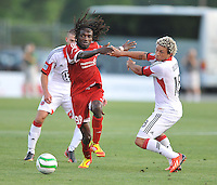 Stanley Nyazamba (99) of the Richmond Kickers goes against Nick DeLeon (18) of D.C. United. D.C. United defeated the Richmond Kicker in penalty kicks 4-2 after finished 0-0 in overtime to advance to the next game in the Lamar Hunt U.S. Open Cup, at City Stadium, Tuesday May 28 , 2013.
