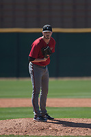 Arizona Diamondbacks relief pitcher Lane Ratliff (18) looks to his catcher for a sign during a Spring Training game against Meiji University at Salt River Fields at Talking Stick on March 12, 2018 in Scottsdale, Arizona. (Zachary Lucy/Four Seam Images)