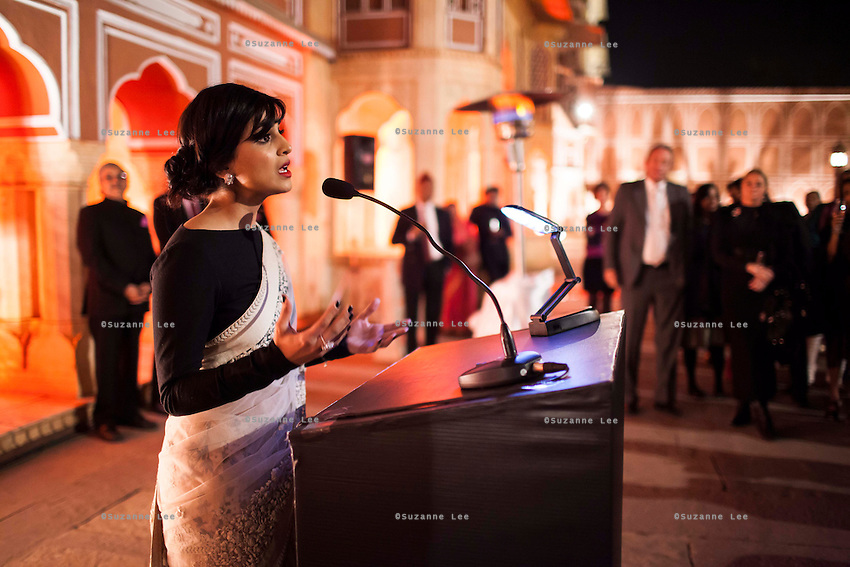 OzFest ambassador Pallavi Sharda (in white saree) wears Argyle Pink Diamond jewelry by Nirav Modi as she gives a speech before a violin recital at the OzFest Gala Dinner in the Jaipur City Palace, in Rajasthan, India on 10 January 2013. Photo by Suzanne Lee
