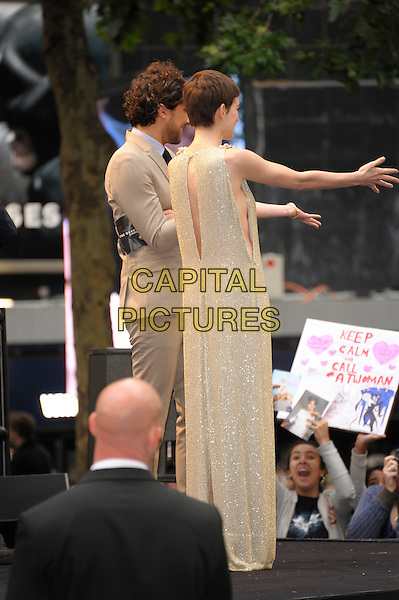 Anne Hathaway (wearing Gucci).'The Dark Knight Rises' European premiere at Odeon Leicester Square cinema, London, England..18th July 2012.full length embellished jewel encrusted flowers floral pearls collar short cropped hair sleeveless silver gold cream beige dress cut out sides hands arms back behind rear.CAP/PL.©Phil Loftus/Capital Pictures.