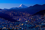 Mt Huayna Potosi receives the last rays of sunlite, and the city of La Paz falls into night.  The mirador Andino Jach'a Apacheta is one of many elevated parks that provide spectacular vistas of La Paz and its mountains.