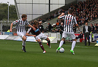 Arvydas Novikovas challenged by David van Zanten and Kenny McLean in the St Mirren v Heart of Midlothian Clydesdale Bank Scottish Premier League match played at St Mirren Park, Paisley on 15.9.12.