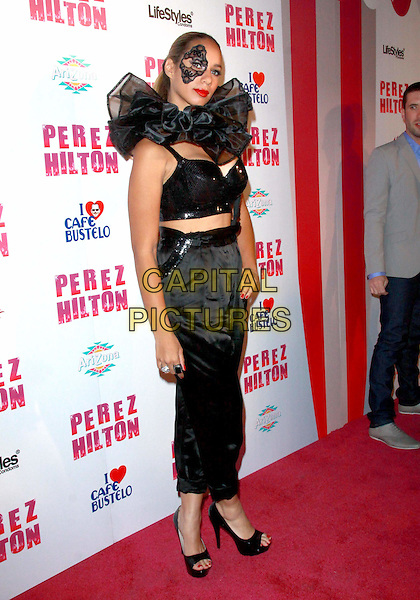 LEONA LEWIS .Attending Perez Hilton's Carn-Evil 32nd Birthday Party held at Paramount Studios, Los Angeles, California, USA, 27th March 2010..arrivals full length black eye patch make-up mask costume trousers bra top crop cropped sequined sequin high waisted silk harem pants open toe platform shoes bustier hand on hip ruffle neck collar rings .CAP/ADM/TC.©T.Conrad/Admedia/Capital Pictures