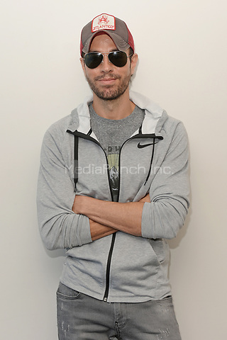 HOLLYWOOD, FL - MAY 03: Enrique Iglesias poses for a portrait at radio station Hits 97.3 on May 3, 2018 in Hollywood, Florida. Credit: mpi04/MediaPunch