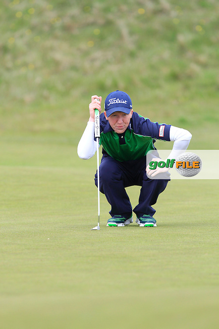 Gavin Moynihan on the 13th green during Round 3 of the Irish Amateur Open Championship at Royal Dublin on Saturday 9th May 2015.<br /> Picture:  Thos Caffrey / www.golffile.ie