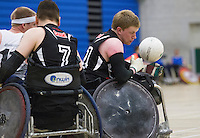 27 MAY 2013 - DONCASTER, GBR - Jim Roberts of West Coast Crash   looks for a way to the goal line during the 2013 Great Britain Wheelchair Rugby Nationals bronze medal match against South Wales Pirates at The Dome in Doncaster, South Yorkshire .(PHOTO (C) 2013 NIGEL FARROW)