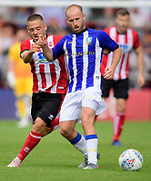 Sheffield Wednesday's Barry Bannan shields the ball from Lincoln City's Jack Payne<br /> <br /> Photographer Chris Vaughan/CameraSport<br /> <br /> Football Pre-Season Friendly - Lincoln City v Sheffield Wednesday - Saturday July 13th 2019 - Sincil Bank - Lincoln<br /> <br /> World Copyright © 2019 CameraSport. All rights reserved. 43 Linden Ave. Countesthorpe. Leicester. England. LE8 5PG - Tel: +44 (0) 116 277 4147 - admin@camerasport.com - www.camerasport.com