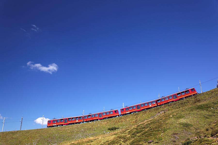 Red rail cars on the Jungfrau railway, Bernese Oberland, Switzerland
