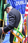 March 16, 2013 - New York, NY, U.S. - Man in colorful sash gets ready to march in the 252nd annual NYC St. Patrick's Day Parade.