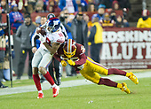 New York Giants wide receiver Roger Lewis (18) makes a reception before being forced out-of-bounds by Washington Redskins free safety D.J. Swearinger (36) in second quarter action at FedEx Field in Landover, Maryland on Thursday, November 23, 2017.<br /> Credit: Ron Sachs / CNP<br /> (RESTRICTION: NO New York or New Jersey Newspapers or newspapers within a 75 mile radius of New York City)