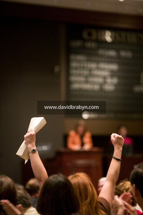 6 October 2006 - New York City, NY - A woman celebrates her successful bid during the auction sale of items from the television show Star Trek at Christie's auction house in New York City, USA, 6 October 2006.