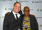 Singer Angelique Kidjo, right, and Kevin Morris arrive for the formal Artist's Dinner honoring the recipients of the 41st Annual Kennedy Center Honors hosted by United States Deputy Secretary of State John J. Sullivan at the US Department of State in Washington, D.C. on Saturday, December 1, 2018. The 2018 honorees are: singer and actress Cher; composer and pianist Philip Glass; Country music entertainer Reba McEntire; and jazz saxophonist and composer Wayne Shorter. This year, the co-creators of Hamilton, writer and actor Lin-Manuel Miranda, director Thomas Kail, choreographer Andy Blankenbuehler, and music director Alex Lacamoire will receive a unique Kennedy Center Honors as trailblazing creators of a transformative work that defies category.<br /> Credit: Ron Sachs / Pool via CNP