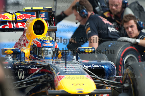 Red Bull Racing Formula One driver Mark Webber of Australia stops in the pit during the free practice session of the Hungarian F1 Grand Prix in Mogyorod (about 20km north-east from Budapest), Hungary. Thursday, 28. July 2011. ATTILA VOLGYI