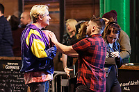 Pictured: A man has his fake boobs touched by another man. Sunday 31 December 2017 and 01 January 2018<br /> Re: New Year revellers in Wind Street, Swansea, Wales, UK