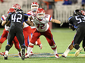 Manatee Hurricanes lineman Kyle Mauk #72 blocking during the first quarter of the Florida High School Athletic Association 7A Championship Game at Florida's Citrus Bowl on December 16, 2011 in Orlando, Florida.  The score at halftime is Manatee 17 - First Coast 0.  (Photo By Mike Janes Photography)
