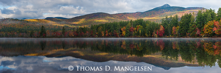 The colors of fall are striking on the shore of Lake Chocorua in new Hampshire.