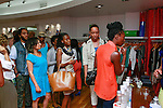Guests line up for cocktails made with Starr African Rum during the African Health Now - Fashion Fete event, at the Tracy Reese store on 641 Hudson Street, June 20, 2013.