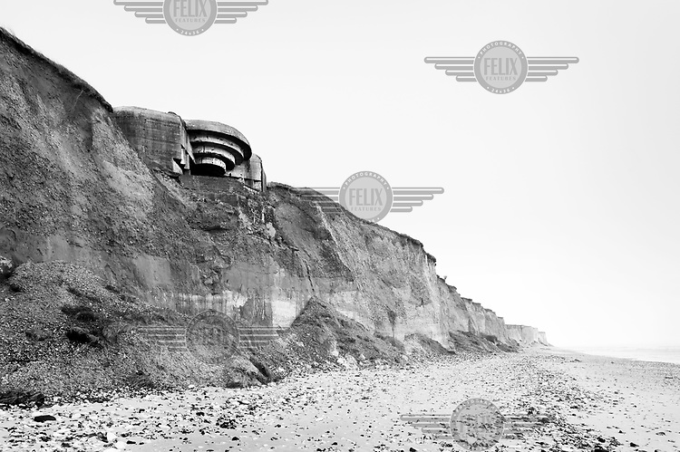 A concrete bunker sits precariously atop a cliff along the English Channel coast near Sangatte along the route of the Atlantic Wall (Atlantikwall in German).The Atlantic Wall (or Atlantikwall in German) was a system of defensive structures built by Nazi Germany between 1942 and 1945, stretching over 1,670 miles (2,690 km) along the coast from the North of Norway to the border between France and Spain at the Pyrenees. The wall was intended to repulse an Allied attack on Nazi-occupied Europe and the largest concentration of structures was along the French coast since an invasion from Great Britain was assumed to be most likely. Slave labour and locals paid a minimum wage were drafted in to supply much of the labour. There are still thousands of ruined structures along the Atlantic coast in all countries where the wall stood except for Germany, where the bunkers were completely dismantled.
