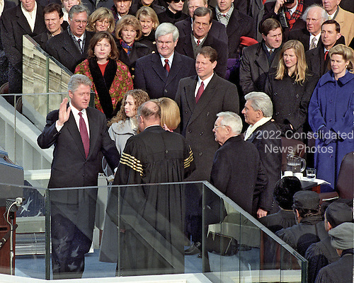 United States President William Jefferson Clinton is sworn-in for his second term in office at the U.S. Capitol on Monday, January 20, 1997.  .Chief Justice of the U.S. William H. Rehnquist administers the oath of office.  Among the dignitaries witnessing the ceremony are U.S. House Majority Leader Dick Armey (Republican of Texas), U.S. Senate Majority Leader Trent Lott (Republican of Mississippi), Speaker of the U.S. House of Representatives Newt Gingrich (Republican of Georgia), Marianne Gingrich, U.S. Vice President Al Gore, U.S. Senator John Warner (Republican of Virginia), U.S. Senator Wendell H. Ford (Democrat of Kentucky), and Chelsea Clinton..Credit: Arnie Sachs / CNP