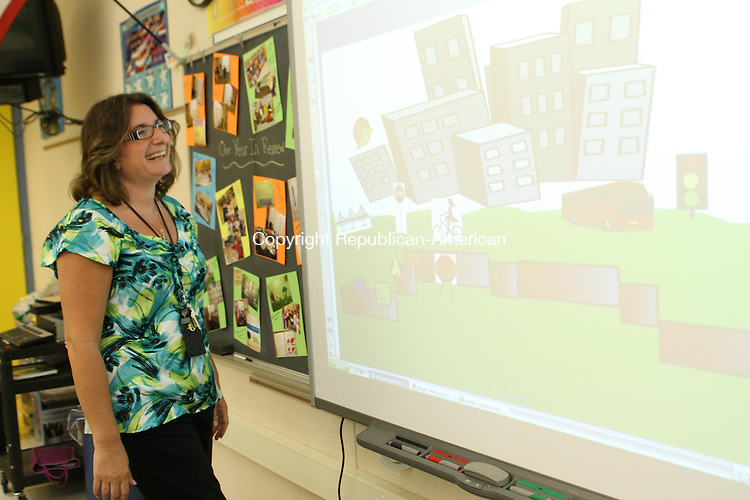 WATERTOWN, CT-13 June 2012- 061312LW01-Watertown's Teacher of the Year, Mary Ellen Lafferty, shows a SMARTBoard activity about shapes in a city. Laraine Weschler Republican-American