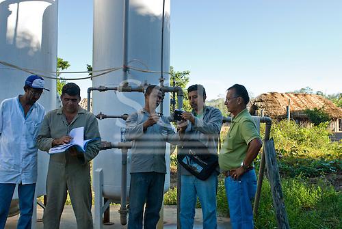 Mato Grosso State, Brazil. Aldeia Metuktire (Kayapo). FUNASA water treatment team: Cicero de Souza, João Saboro, José Borges, Vicente Correa de Mornes Filho and Francisco Santiago.