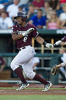 Mississippi State designated hitter Derrick Armstrong (6) follows through on his swing against the Indiana Hoosiers during Game 6 of the 2013 Men's College World Series on June 17, 2013 at TD Ameritrade Park in Omaha, Nebraska. The Bulldogs defeated Hoosiers 5-4. (Andrew Woolley/Four Seam Images)