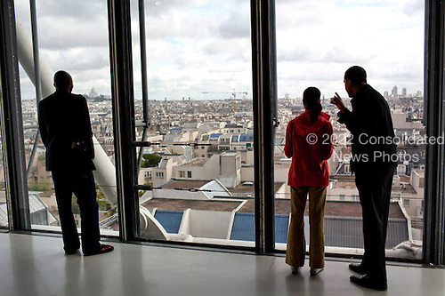 Paris, France - June 7, 2009 -- United States President Barack Obama points out a landmark to daughter Malia while touring the Pompidou Centre modern art museum in Paris, Sunday, June 7, 2009..Mandatory Credit: Pete Souza - White House via CNP