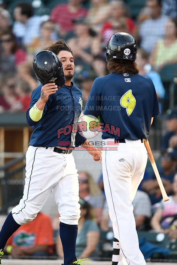 Left fielder Jay Jabs (7) of the Columbia Fireflies is congratulated by Gene Cone after scoring a run in a game against the Lexington Legends on Thursday, June 8, 2017, at Spirit Communications Park in Columbia, South Carolina. Columbia won, 8-0. (Tom Priddy/Four Seam Images)