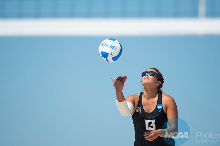 GULF SHORES, AL - MAY 07: Zalopany Hannah (13) of the University of Hawaii serves the ball during the Division I Women's Beach Volleyball Championship held at Gulf Place on May 7, 2017 in Gulf Shores, Alabama.Pepperdine defeated Hawaii 3-0 to advance to the championship game.  (Photo by Stephen Nowland/NCAA Photos via Getty Images)