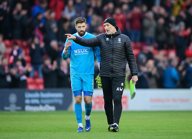 Lincoln City's Josh Vickers, left, and Lincoln City's first team goalkeeping coach Andy Warrington at the end of the game<br /> <br /> Photographer Chris Vaughan/CameraSport<br /> <br /> The EFL Sky Bet League Two - Lincoln City v Mansfield Town - Saturday 24th November 2018 - Sincil Bank - Lincoln<br /> <br /> World Copyright © 2018 CameraSport. All rights reserved. 43 Linden Ave. Countesthorpe. Leicester. England. LE8 5PG - Tel: +44 (0) 116 277 4147 - admin@camerasport.com - www.camerasport.com