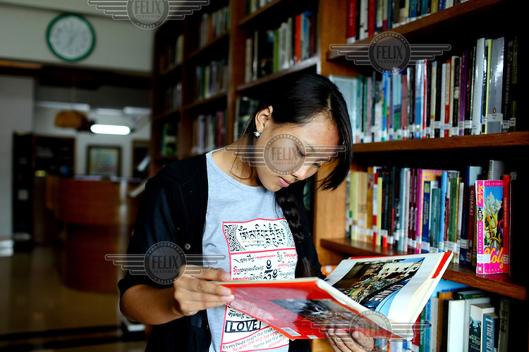 Yina from Tibet reads a book in the library at the Asian University for Women. She has been studying here for four years... /Felix Features