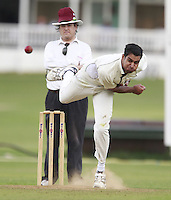 Nish Patel bowls for South Hampstead during the Middlesex County Cricket League Division Three game between Highgate and South Hampstead at Park Road, Crouch End on Sat Aug 2, 2014