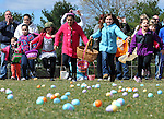 Kids off and running at the 41st Annual Imperial Oil Egg Hunt,  Friday, April 6, 2012, at South Windsor High School. (Jim Michaud/Journal Inquirer).