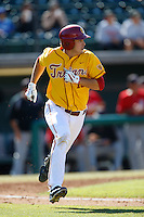 James Roberts #15 of the USC Trojans runs the bases against the Cal State Northridge Matadors at Dedeaux Field on February 24, 2013 in Los Angeles, California. (Larry Goren/Four Seam Images)