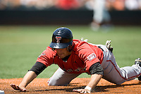 Designated Hitter Nick Popescu #7 of the Texas Tech Red Raiders dives back into first base against the Texas Longhorns on April 17, 2011 at UFCU Disch-Falk Field in Austin, Texas. (Photo by Andrew Woolley / Four Seam Images)