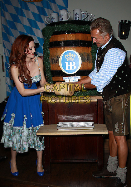 LAS VEGAS, USA, OCTOBER 17: Holly Madison taps the ceremonial Oktoberfest keg at Hofbrauhaus, Las Vegas, NV, USA. <br />  CAP/ADM/MJT<br /> &copy; MJT/AdMedia/Capital Pictures