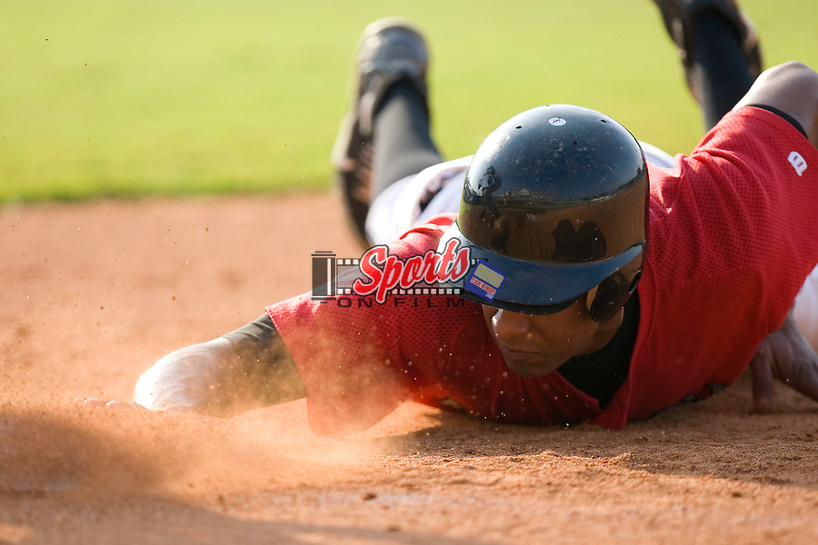 Kannapolis Intimidators outfielder Anderson Gomes dives back to first base in game action versus the Asheville Tourists at Fieldcrest Cannon Stadium in Kannapolis, NC, Monday, August 28, 2006.  The Tourists defeated the Intimidators 7-4 in the first game of a double-header.