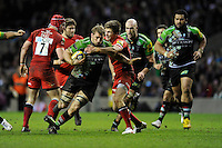 Chris Robshaw of Harlequins is tackled by Owen Farrell of Saracens during the Aviva Premiership match between Harlequins and Saracens at Twickenham on Tuesday 27 December 2011 (Photo by Rob Munro)