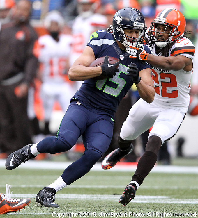 Seattle Seahawks wide receiver Jermaine Kearse (15) runs after catching a pass against Cleveland Browns defensive back Tramon Williams (22) at CenturyLink Field in Seattle, Washington on December 20, 2015. The Seahawks clinched their fourth straight playoff berth in four seasons by beating the Browns 30-13.  ©2015. Jim Bryant Photo. All Rights Reserved.