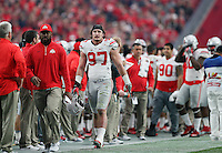 Ohio State Buckeyes defensive lineman Joey Bosa (97) walks off the field after being ejected for a hit on Notre Dame Fighting Irish quarterback DeShone Kizer (14) during the first quarter of the Battlefrog Fiesta Bowl at University of Phoenix Stadium in Glendale, Arizona on Jan. 1, 2016. (Adam Cairns / The Columbus Dispatch)