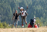 Saint Vincent-les-Forts, Lac de Serre Poncon, France, September 2007. Instructor Gijsbert Hoogerkamp guides a student into the air. Jeanine van de Wetering joined her father for a week long paragliding course. Volantis is home to the paragliding school Inferno. In one week time, students learn to fly the paraglider and earn their mountain licence 1. Photo by Frits Meyst/Adventure4ever.com