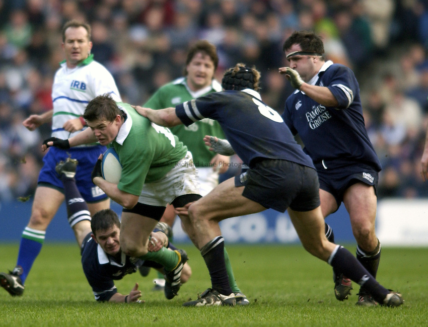 Photo. Jed Wee.Scotland v Ireland, Rugby Union Six Nations Championship, Murrayfield, Edinburgh. 16/02/2003..Ireland's Brian O'Driscoll is tackled by Gordon Ross, Simon Taylor and Tom Smith (L to R).