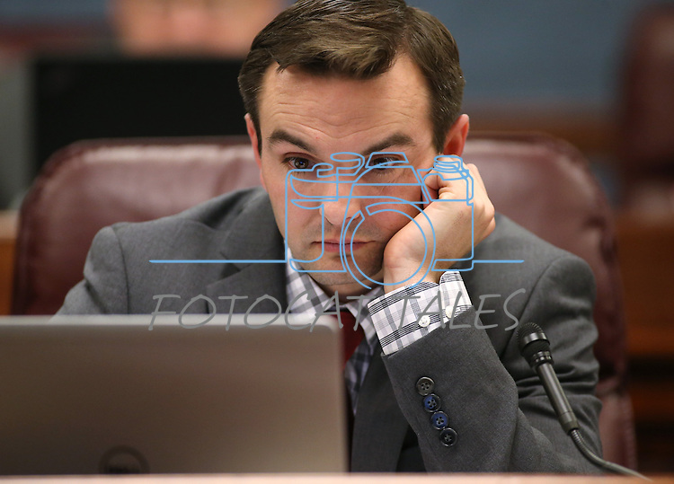 Nevada Assemblyman Derek Armstrong, R-Las Vegas, worsk in committee at the Legislative Building in Carson City, Nev., on Friday, April 10, 2015. <br /> Photo by Cathleen Allison