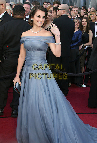 Penelope Cruz.84th Annual Academy Awards held at the Hollywood & Highland Center, Hollywood, California, USA..February 26th, 2012.full length blue off the shoulder dress hand arm waving  oscars.CAP/ADM.©AdMedia/Capital Pictures.