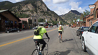 NWA Democrat-Gazette/FLIP PUTTHOFF <br /> Tom and Karen Mowry of Nob Hill, east of Springdale, ride     September 2015    through downtown Frisco, Colo., on their way to Copper Mountain and Vail Pass.