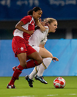 Amy Rodriguez, Candace Chapman. The USWNT defeated Canada in extra time, 2-1, during the 2008 Beijing Olympics in Shanghai, China.